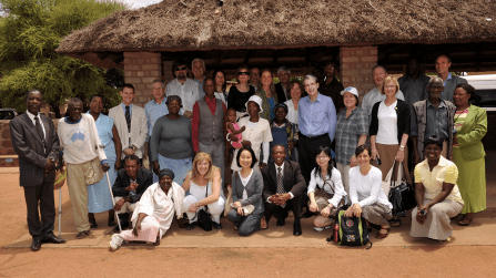 The HSPH delegation, BHP staff and elders of Mochudi gather at the kgotia, the public meeting place of a Botswana village.