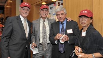 Paul Finnegan, Eric Larson, and Barbara Wu in HAI caps with Max Essex