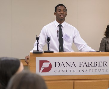 Participant M. Spearman sharing his research project