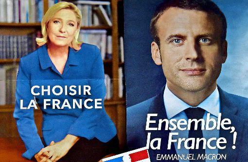Das Land brodelt – die Kandidaten bemühen sich auf den Plakaten um Seriosität. Foto: AFP