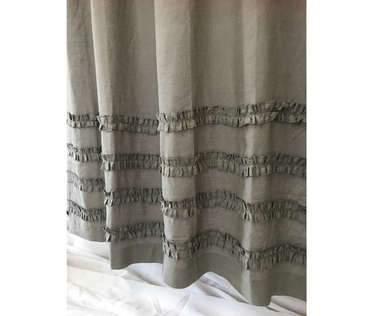medium grey linen shower curtains with 4 rows of ruffles dress up your tub