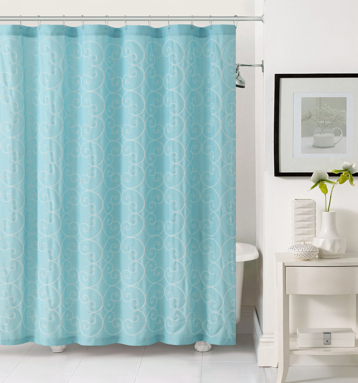 light aqua blue fabric shower curtain with white embroidered swirl circle design