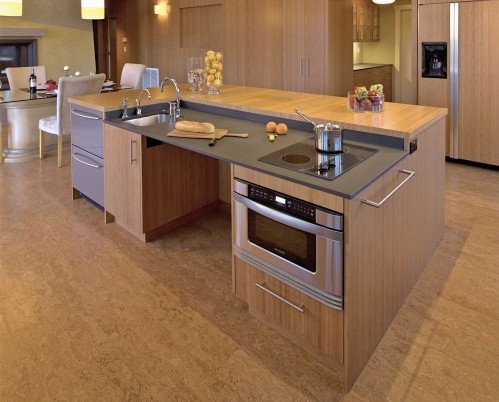 This kitchen by Mikiten Architecture & Universal Design was designed for a woman who uses an electric wheelchair.