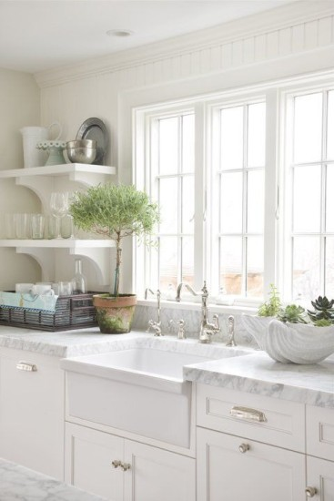 An all-white kitchen appears light and spacious.