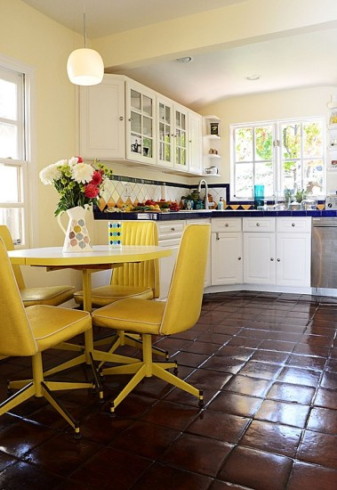 The pop of yellow is fun in the otherwise white kitchen.