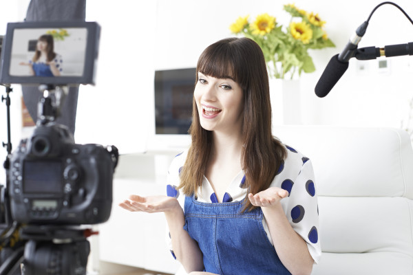Female Vlogger Recording Broadcast At Home