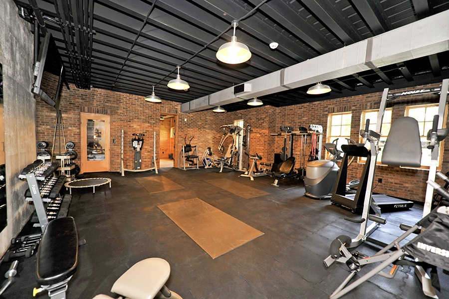 Set up as a professional gym, the workout area of this lakefront house in Georgia provides ample space for exercising.