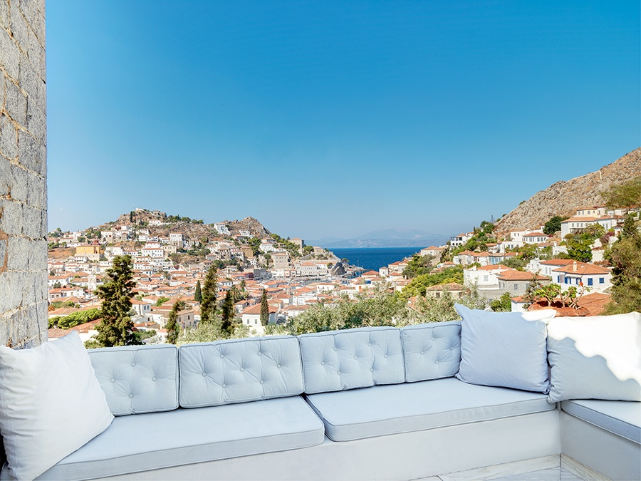 The patios and terraces at this centuries-old villa in Hydra, Greece, have been designed with great care so as to blend the old with the new.