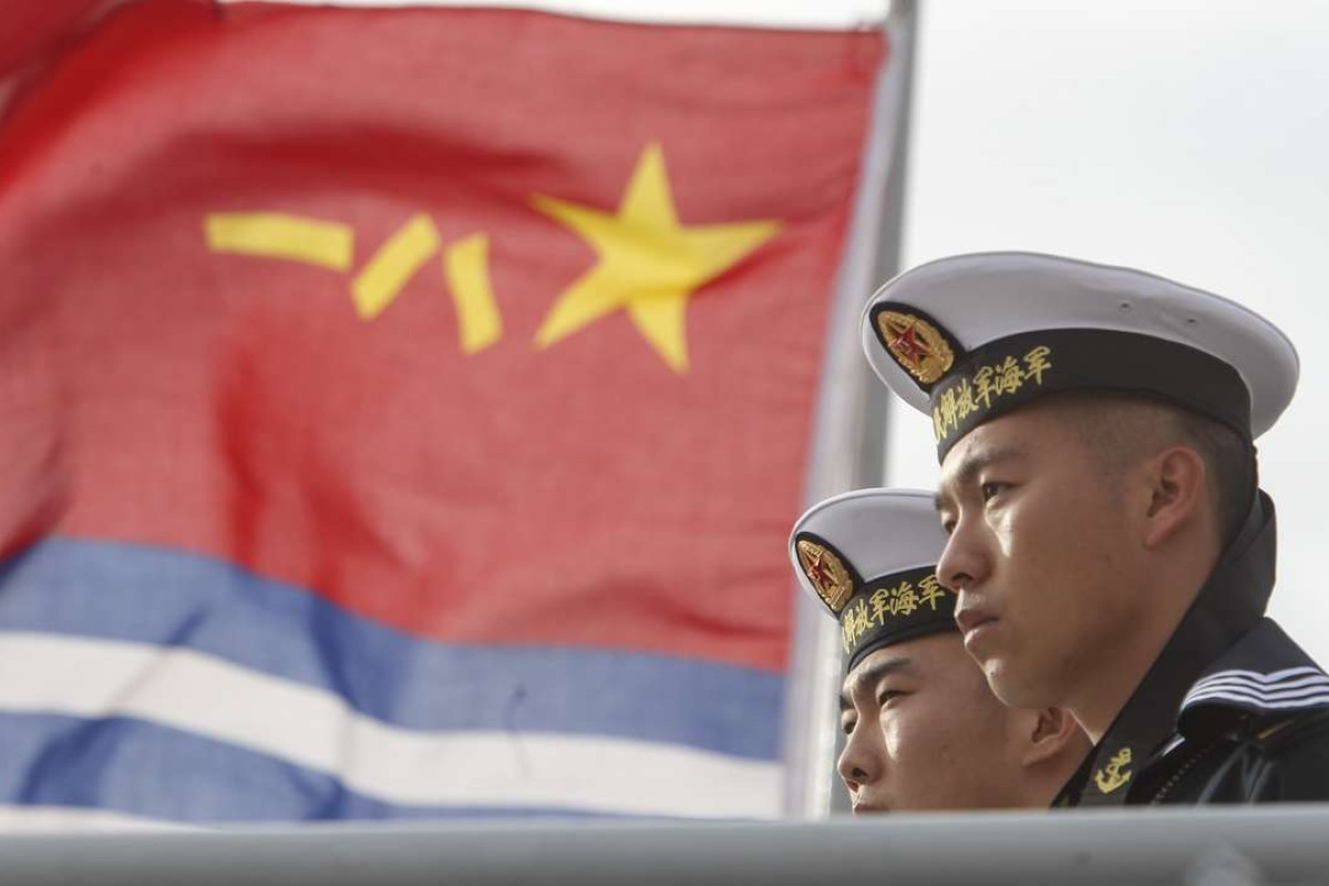 Chinese Navy sailors stand on a Chinese Navy frigate visiting San Diego in December. Photo: AFP