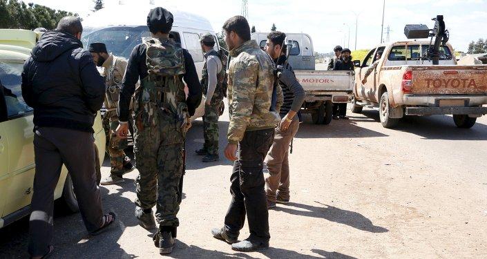 Jabhat al-Nusra militants at the entrance of Idlib city