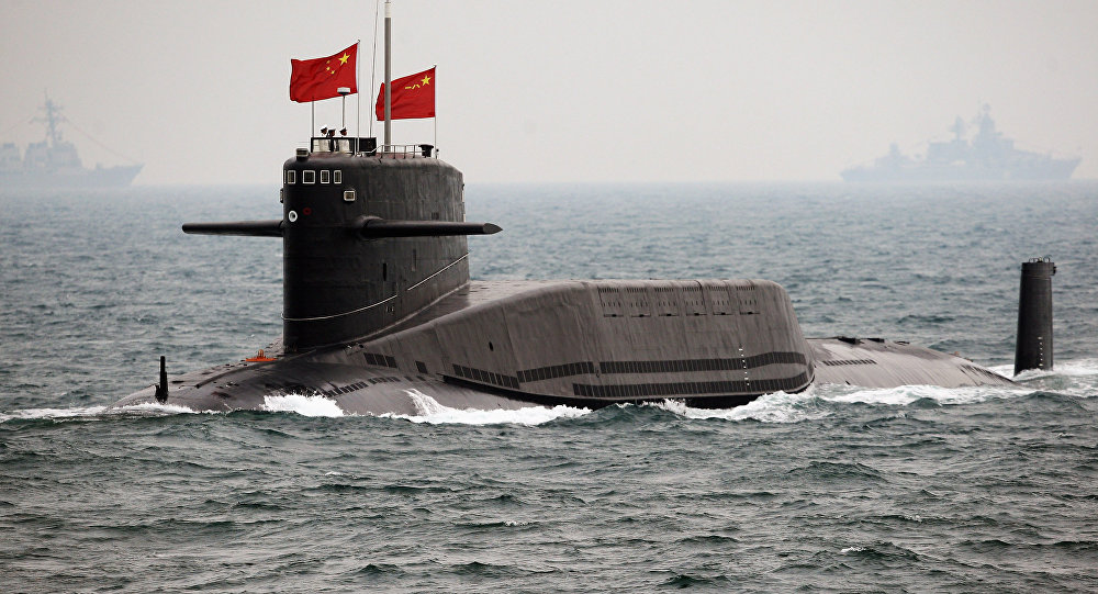 A Chinese Navy submarine attends an international fleet review to celebrate the 60th anniversary of the founding of the People's Liberation Army Navy on April 23, 2009 off Qingdao in Shandong Province