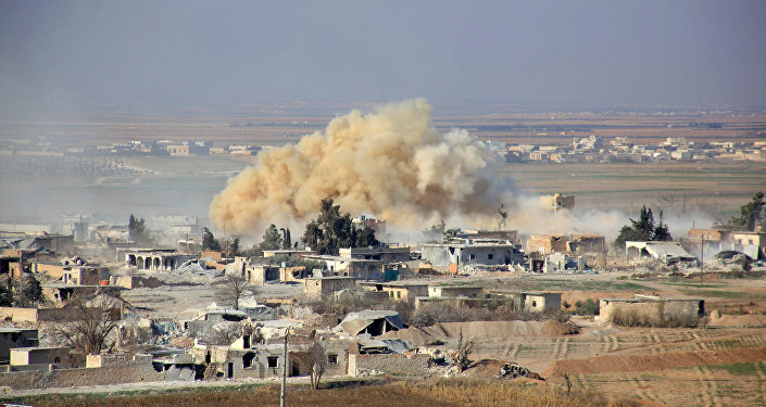 File Photo: Smoke rises from buildings in the area of Tal Sharba following government air strikes on the outskirts of the northern Syrian city of Aleppo on December 27, 2015, as government forces seized the area from Islamic State (IS) group jihadists