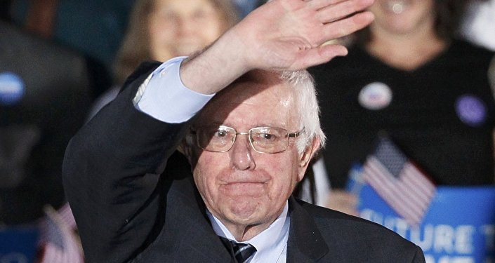 Democratic U.S. presidential candidate Bernie Sanders waves after winning at his 2016 New Hampshire presidential primary night rally in Concord, New Hampshire February 9, 2016