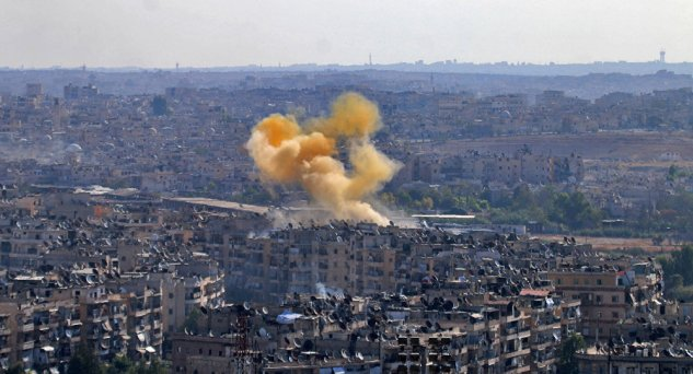 Smoke rises from reported opposition fire from buildings in an eastern government-held neighbourhood of the northern Syrian city of Aleppo