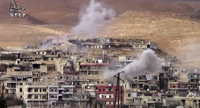 This frame grab from video provided By Step News Agency, a Syrian opposition media outlet that is consistent with independent AP reporting, shows smoke rise from the alleged government forces shelling on Wadi Barada, northwest of Damascus, Syria