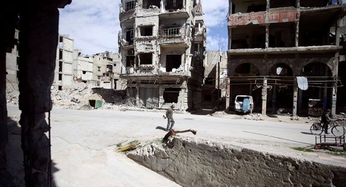 People are seen in the besieged town of Douma, Eastern Ghouta, in Damascus, Syria March 9, 2018