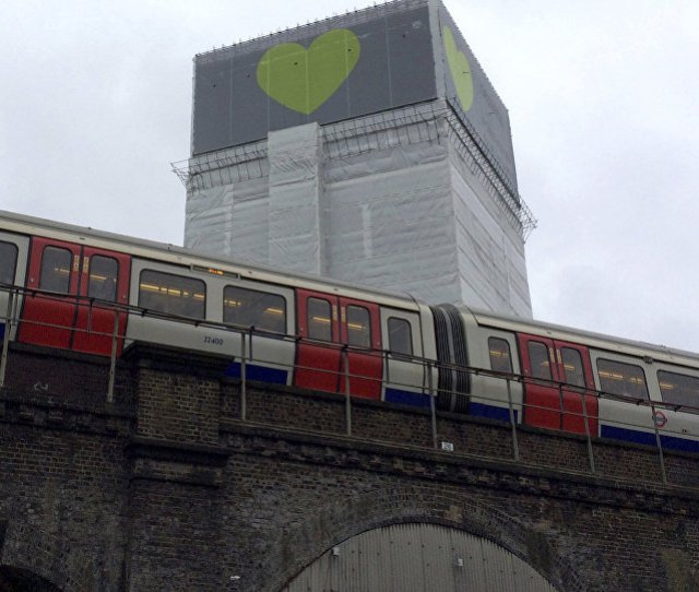 A London Underground Train Comes To A Halt Next To Grenfell Tower As A Minutes Silence