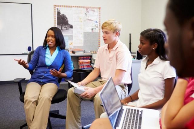 african, american, teacher, class, student, teen, high, school, classroom, laptop, pupil, debate, 17, years, teenage, boy, sitting, horizontal, tablet, talking, thirties, male, 15 Easiest Debate Topics for High School