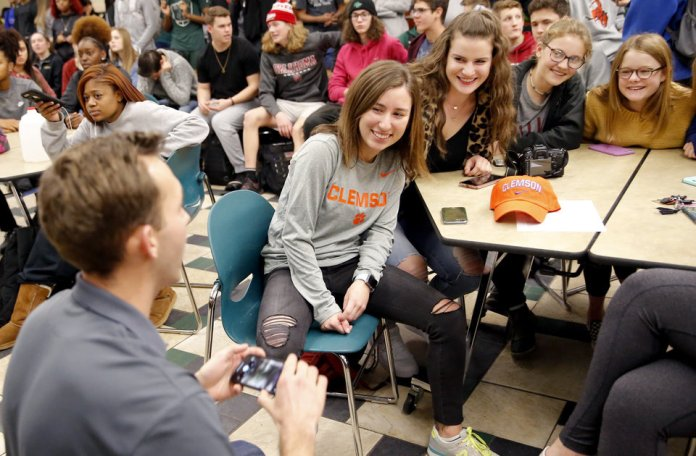 Photo - Catherine O'Keefe takes a picture with friends after signing with Clemson rowing during signing day ceremony at Edmond Santa Fe High School in Edmond, Okla., Wednesday, Feb. 6, 2019. Photo by Sarah Phipps, The Oklahoman