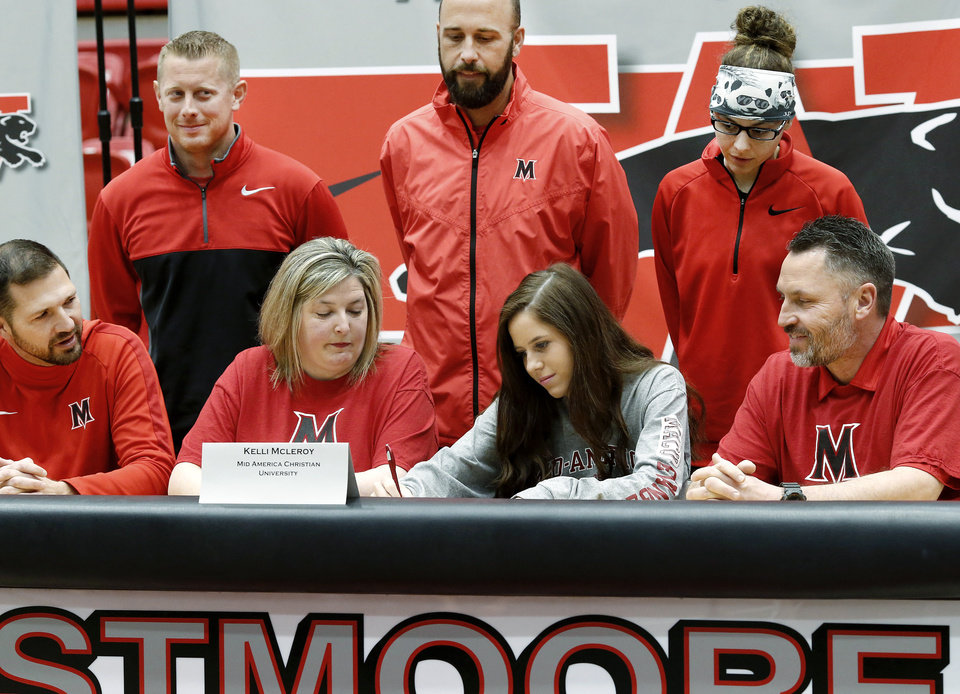 Photo - Kelli McLeroy signs letter to play at Mid America Christian University during Signing Day event at Westmoore High School on Wednesday, Feb. 6, 2019.  Photo by Jim Beckel, The Oklahoman.
