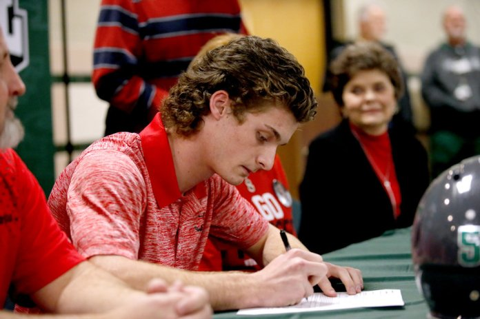 Photo - Braden Reichert signs to play football at NWOSUduring signing day ceremony at Edmond Santa Fe High School in Edmond, Okla., Wednesday, Feb. 6, 2019. Photo by Sarah Phipps, The Oklahoman