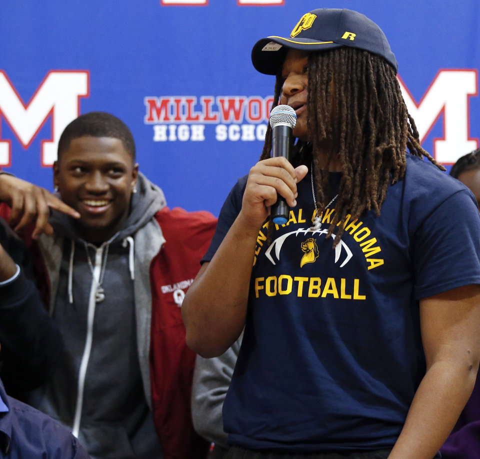 Photo - Millwood's Isaiah Major speaks as his cousin OU signee Marcus Major looks on during the signing ceremony for high school football players in the Millwood Field House in Oklahoma City, Wednesday, Feb. 6, 2019. Isaiah Major will play football at UCO. Photo by Nate Billings, The Oklahoman