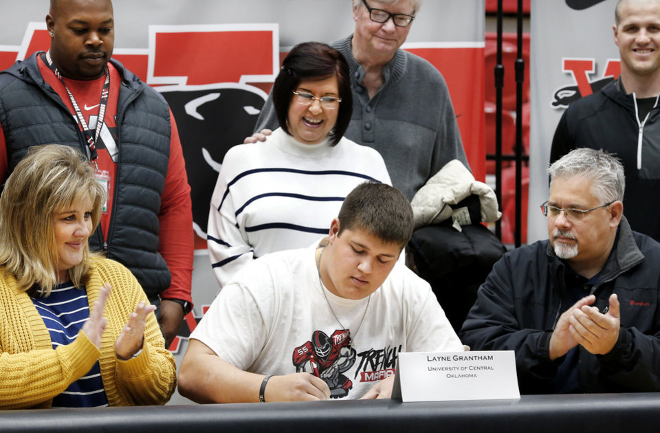 Photo - Layne Grantham signs a letter to play at University of Central Oklahoma during Signing Day event at Westmoore High School on Wednesday, Feb. 6, 2019.  Photo by Jim Beckel, The Oklahoman.