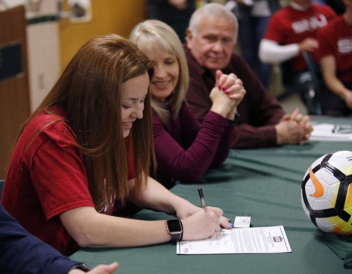 Photo - Taylor Dashney signs to soccer at Bethel College during signing day ceremony at Edmond Santa Fe High School in Edmond, Okla., Wednesday, Feb. 6, 2019. Photo by Sarah Phipps, The Oklahoman