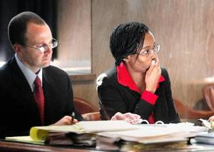 photo - Exondia Salado, right, sits with an attorney in the Oklahoma County Courthouse Tuesday, March 22. Photo by Jim Beckel