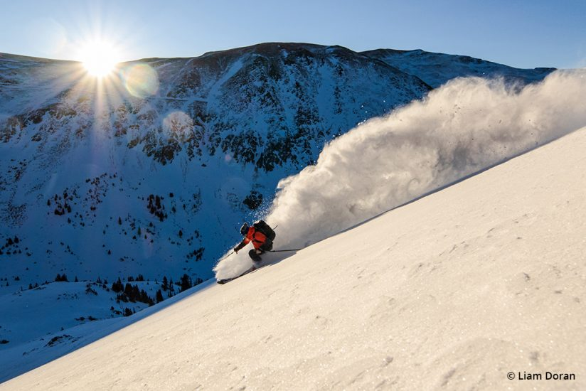 Image of a skier just after dawn.
