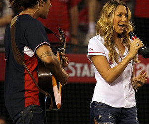 ANAHEIM CA - JULY 13:  Singer Colbie Caillat sings God Bless America during the seventh inning stretch during the 81st MLB All-Star Game at Angel Stadium of Anaheim on July 13 2010 in Anaheim California.  (Photo by Stephen Dunn/Getty Images)