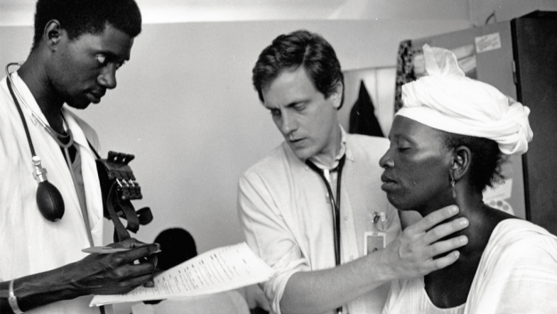 Marlink examining a patient in Senegal in 1987
