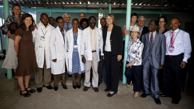 Ogwu (far right) in Mochudi, Botswana. In 2009, Harvard President Drew Faust (front center) visited the village where HAI conducts clinical trials. photo by Justin Ide/Harvard News Office