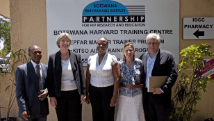 1:00 p.m. Faust poses with BHP staff who are involved in AIDS training programs for doctors, nurses and other healthcare workers. From left to right: Joseph Makhema, Faust, Tendani Gaolathe, Christine Bussmann, and Richard