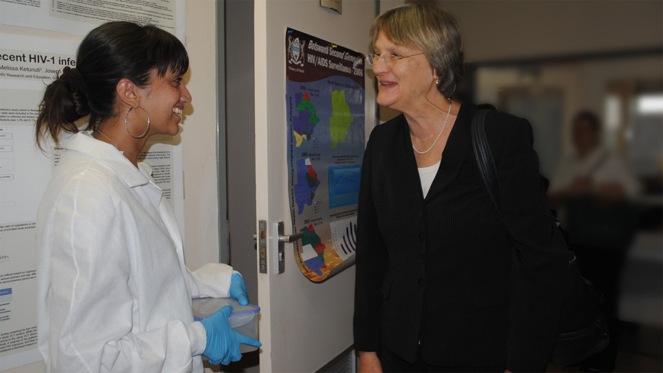 Dr. Raabya Rossenkhan talking to Harvard President Drew Faust, touring the lab of the Botswana–Harvard AIDS Institute Partnership
