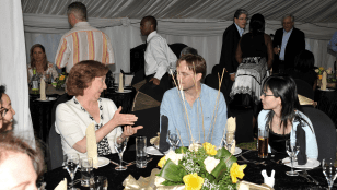 At a Welcome Dinner at the Gaborone Sun Hotel, the HSPH delegation meets the staff of the Botswana-Harvard Partnership. Nancy Lukitsh (left) talks with Erik van Widenfelt (center) from the BHP and Dr. Tianxi Cai (right), an HSPH biostatistician.