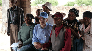 Dean Julio Frenk talks with elders of the village of Mochudi, where the Harvard AIDS Initiative is conducting a community-wide HIV prevention project.