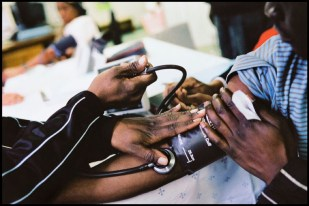 Botswana - An AIDS patient has his blood pressure taken during a checkup in Botswana. ©Dominic Chavez