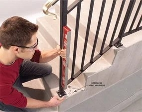 Safety First Install An Outdoor Stair Railing — The Family Handyman | Outside Metal Stair Railing | Steel | Concrete | Steel Handrail | Porch | Outdoor Stair
