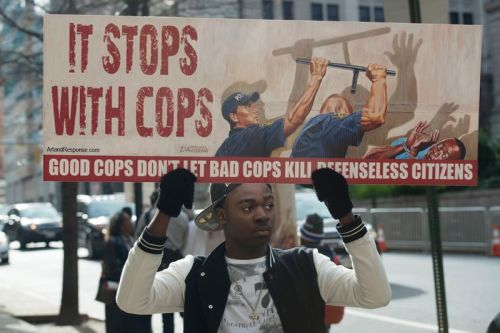 A young protester outside the trial of William Porter, one of the Baltimore police officers charged in the death of Freddie Gray.