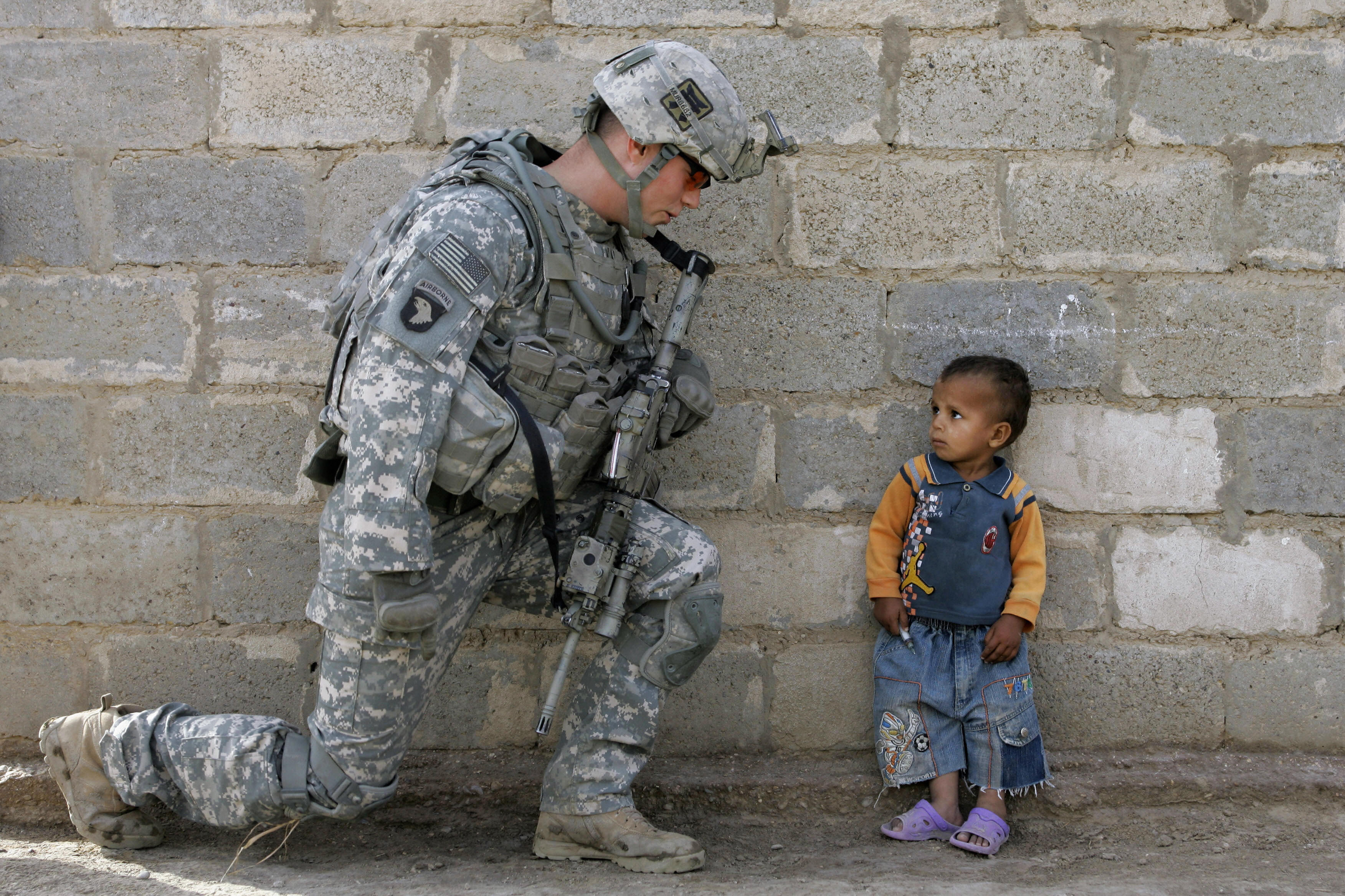 A US soldier with an Iraqi child in Baghdad, 2008. Mauricio Lima/AFP/Getty Images