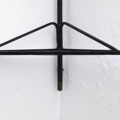 etagere d angle en metal noir et laiton par mathieu mategot france 1950s