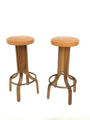camel colored leather walnut plywood swivel stools 1970s set of 4
