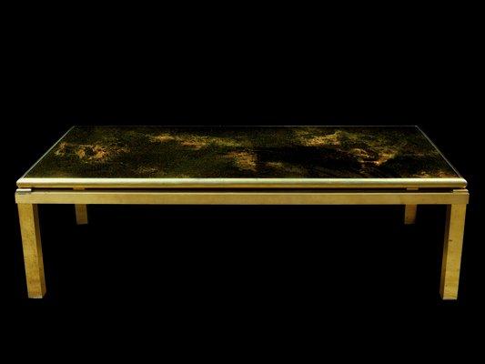 table basse en laiton et verre a eruption solaire par maison jansen