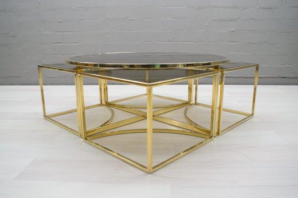 hollywood regency brass smoked glass nesting coffee table set 1960s
