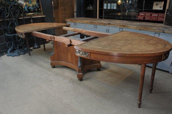 table de salle a manger ovale a rallonge vintage style louis xvi en chene incruste et bronze annees 20
