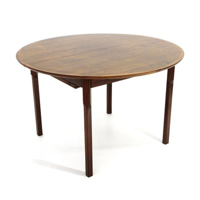 round wooden extendable dining table 1960s