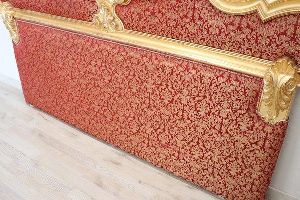 tete de lit en bois sculpte et dore avec tissu 1930s