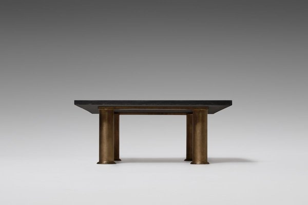 engraved black granite and gilt coffee table by guy de jong