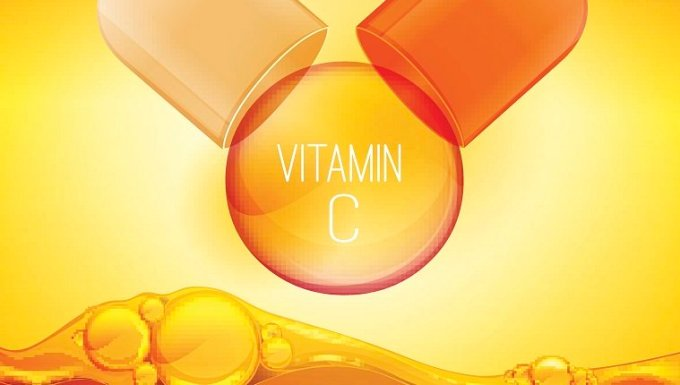 Open pilll with vitamin C. Shining golden essence circle droplet. Vector illustration in orange and yellow colours. Medical and pharmaceutical image.